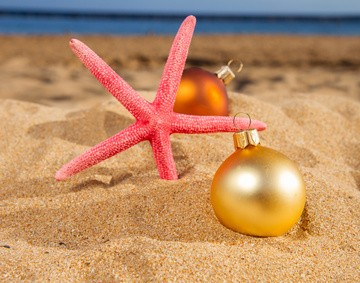 christmas balls with red starfish on sunny  beach